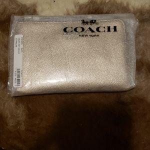 Coach wristlet champagne